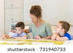 teacher woman play with two... | Shutterstock . vector #731940733
