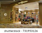 Small photo of SINGAPORE - OCTOBER 4, 2017: The outer facade of the Tory Burch boutique in Changi Airport. Tory Burch is an American fashion label owned, operated and founded by American designer Tory Burch.