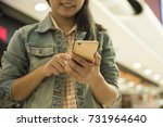 young woman using cellphone in... | Shutterstock . vector #731964640