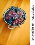 red and white grapes on wooden... | Shutterstock . vector #731966038
