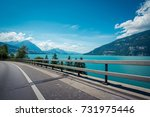 gorgeous scenery view of lakeside road in the Alpines with beautiful lake in Switzerland - stock photo