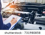 mechanic holding a clipboard of ... | Shutterstock . vector #731980858