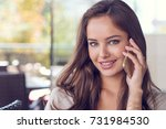 young woman in cafe drinking... | Shutterstock . vector #731984530