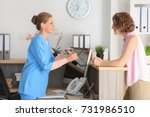 young female receptionist with... | Shutterstock . vector #731986510