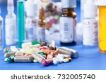 capsule tablets and vials with... | Shutterstock . vector #732005740