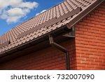close up on rain gutter system... | Shutterstock . vector #732007090
