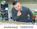 man performs product creation | Shutterstock . vector #732031210