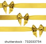 identical golden bows on a... | Shutterstock . vector #732033754