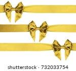 identical golden bows on a... | Shutterstock . vector #732033754