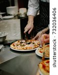 chef cutting pizza with the...   Shutterstock . vector #732036406