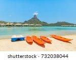orange kayaks on white sand... | Shutterstock . vector #732038044