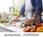 man cooking in the kitchen and...   Shutterstock . vector #732059224