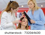 make up artist conducts a... | Shutterstock . vector #732064630
