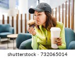 a woman in a fast food cafe... | Shutterstock . vector #732065014