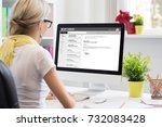 businesswoman reading email on... | Shutterstock . vector #732083428