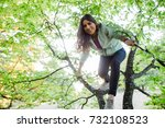 young energetic woman climbing... | Shutterstock . vector #732108523