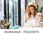 smiling cute girl in straw hat... | Shutterstock . vector #732123373