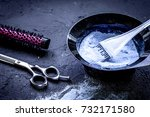 Small photo of hair dye with brush on dark background