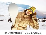 happy girl snowboarder with...   Shutterstock . vector #732172828