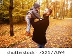 father and son in autumn park | Shutterstock . vector #732177094