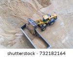 yellow wheel loader loading...   Shutterstock . vector #732182164