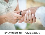 the bride and groom exchange... | Shutterstock . vector #732183073