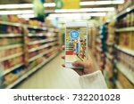 woman doing grocery shopping at ... | Shutterstock . vector #732201028
