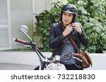 pensive asian biker wearing... | Shutterstock . vector #732218830