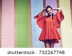 cheerful woman spinning in... | Shutterstock . vector #732267748