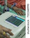 woman holding electrocardiogram ...   Shutterstock . vector #732268990
