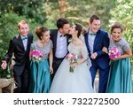 newlyweds and friends pose in a ... | Shutterstock . vector #732272500