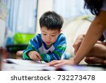 children boy doing homework. ... | Shutterstock . vector #732273478