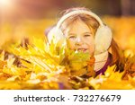 little girl in earflaps playing ... | Shutterstock . vector #732276679