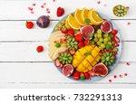 platter fruits and berries.... | Shutterstock . vector #732291313