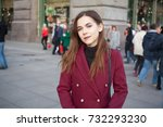a woman stands on a busy... | Shutterstock . vector #732293230