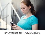 an active woman using a mobile... | Shutterstock . vector #732305698