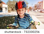 happy boy ride a bicycle in... | Shutterstock . vector #732330256