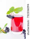 Small photo of Glass of aronia juice with berries