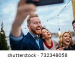 friends taking a photo with... | Shutterstock . vector #732348058