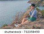 Small photo of East Asian girl Put on a blue shirt, take a sit, take a photo, take a holiday