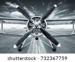 biplane on a runway | Shutterstock . vector #732367759