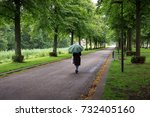 a single woman with a green... | Shutterstock . vector #732405160