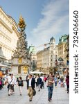 Small photo of VIENNA, AUSTRIA - AUGUST 28: People in the pedestrian Area of Vienna, Austria on August 28, 2017. Foto with view to the baroque Plague column.
