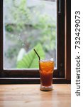 a glass of lemon iced tea on... | Shutterstock . vector #732429073