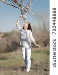 girl in a neglected almond... | Shutterstock . vector #732448888