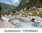 wooden hut on the wild river | Shutterstock . vector #732504634