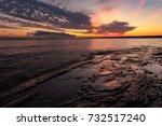 a dramatic sunrise over lake... | Shutterstock . vector #732517240