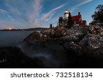 eagle harbor light stands above ... | Shutterstock . vector #732518134