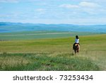 Riding horse in grassland of Hulun Buir League of Inner-Mongolia, China - stock photo