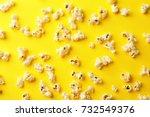 scattered popcorn on color... | Shutterstock . vector #732549376